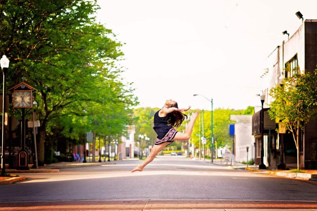 dancer jumping across street summer. akron canton ohio