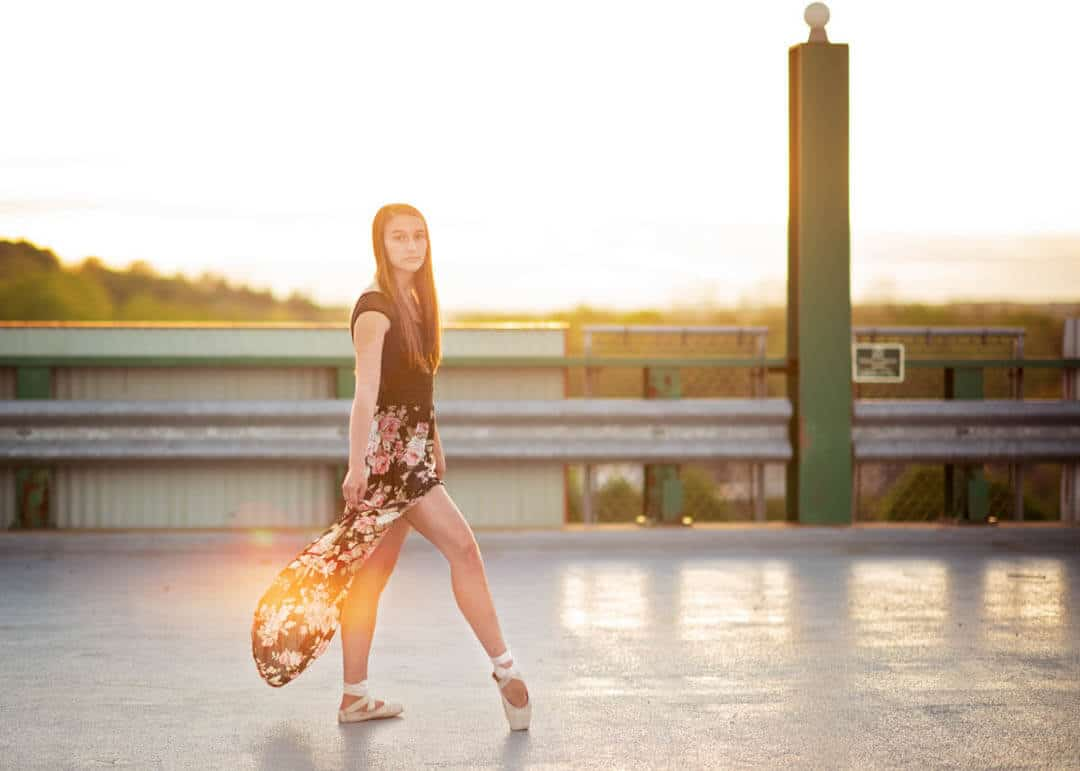 dancer girl in ballet shoes on rooftop at sunset. iris lane photography akron canton ohio