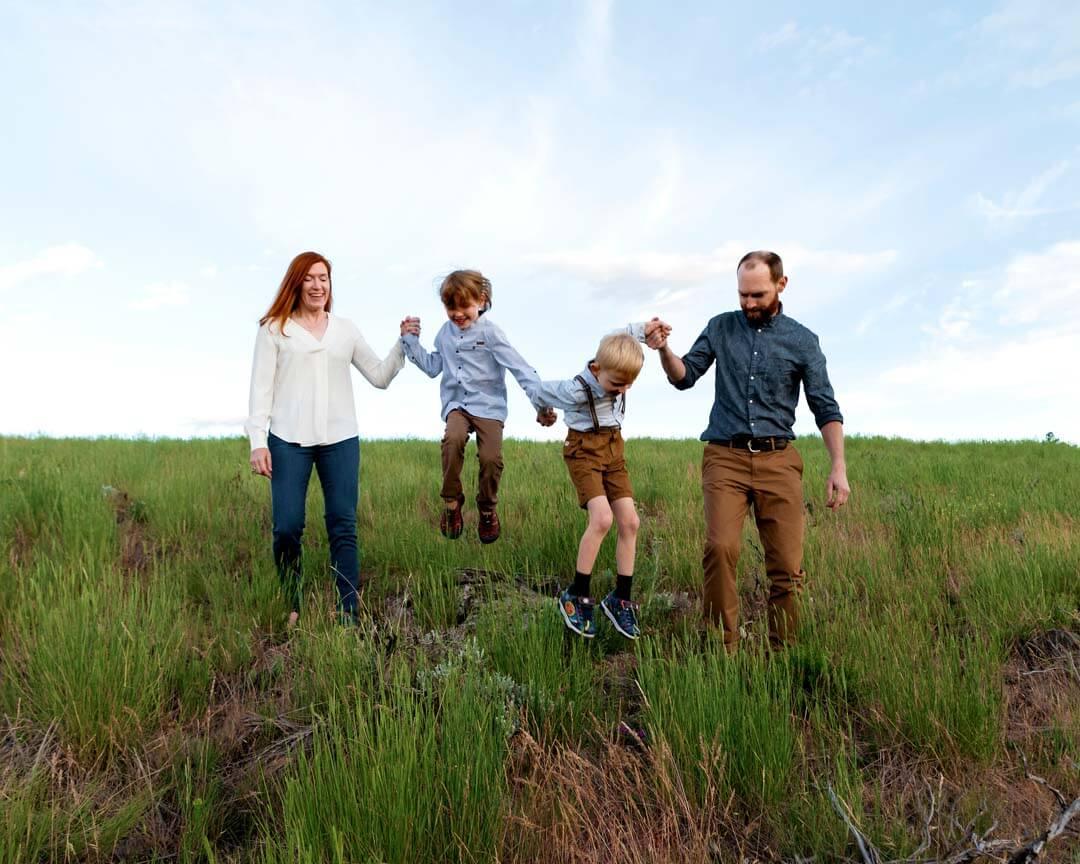FAMILY of 4 outdoors sky. pregnant woman black and white silhouette. iris lane photography maternity photo akron canton ohio