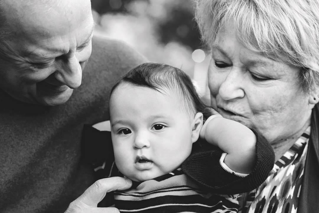grandparents and toddler black and whit photo.  iris lane photography akron canton green hartville ne ohio