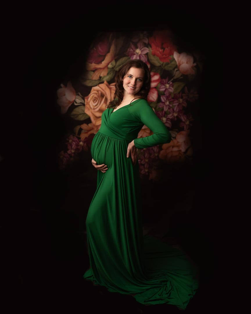 pregnant woman in green dress in studio session. iris lane photography akron canton ohio
