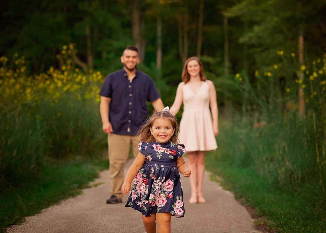 family of 3 walking on a path. Iris lane photography akron canton ohio